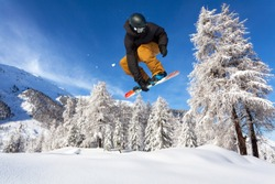 jump with snowboard in fresh snow