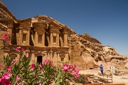 8 June 2014: Tourists om front of the facade of the Monastery, one of the famous monuments of the ancient Nabatean city of Petra, Jordan.