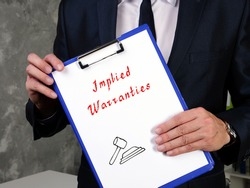 Juridical concept meaning Implied Warranties with sign on the page.