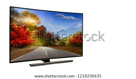 4k monitor isolated on white.  The road is rural, unpaved in the steppes at sunset. Modern, elegant TV 4 K, with incredibly beautiful colors of the image. #1218230635