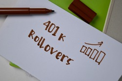 401k Rollovers text on sticky notes isolated on office desk.
