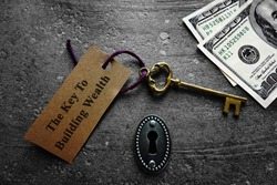 Key to building wealth, with keyhole and money