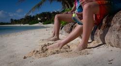 Kids feet in sand on beach