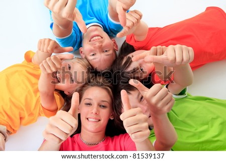 Kids giving the thumbs up
