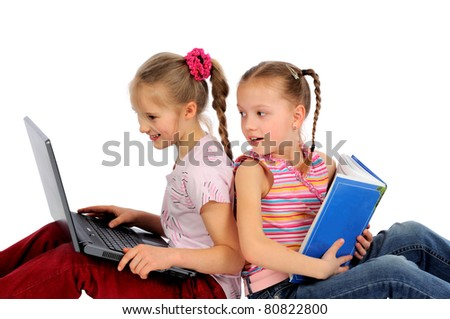 Kids with laptop and book