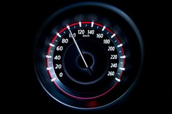 100 Kilometers per hour,light with car mileage with black background,number of speed,Odometer of car