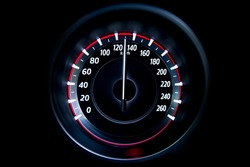 130 Kilometers per hour,light with car mileage with black background,number of speed,Odometer of car