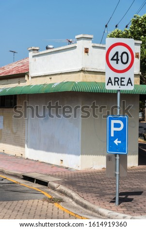 40 kilometre per hour speed sign & Parking sign