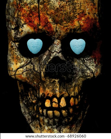 """kiss me, I'm yours"" written on candy hearts inside a textured skull's eye sockets"
