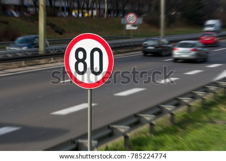80km/h Speed limit sign with a traffic in the background on a highway full of cars #785224774