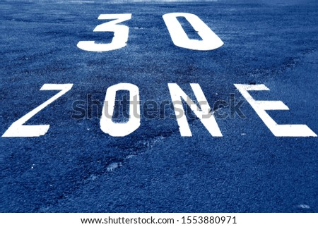 30 km/h zone marked on a road lane #1553880971