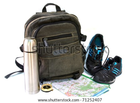 knapsack with sneakers on white background