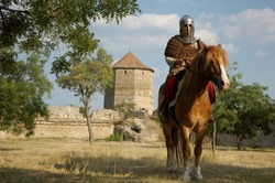 Knight riding a horse in castle