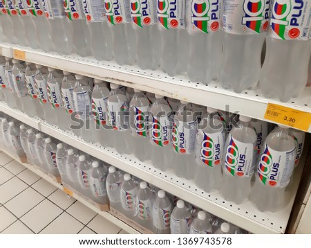 Kuala Lumpur, Malaysia - 09 April 2019 : Lots of 100 PLUS isotonic drink water display for sell in the supermarket shelf. - image  #1369743578