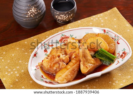 'Kue Arani' is a dish of fish head and wings simmered with Japanese seasonings and sliced radish. Stock fotó ©