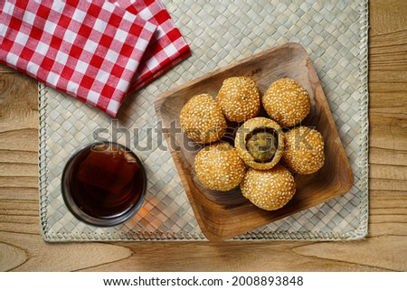 'Kue Onde Onde' Or jiandui or fried dumpling is a type of fried Chinese pastry made from glutinous rice flour. The pastry is coated with sesame seeds on the outside and is crisp and chewy. Stock photo ©