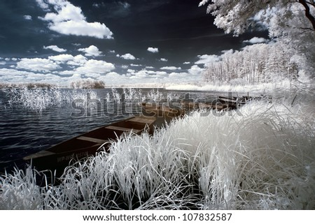 Lake and boats in Greater Poland, Poland. The infrared image