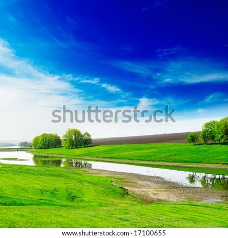 Lake, green grass, blue sky