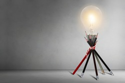 Lamp bulb on pencil.Idea concept and thinking in business or education.Opportunity for creative in work.