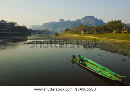 Landscape with boat docked on the river, Vang Vieng, Laos