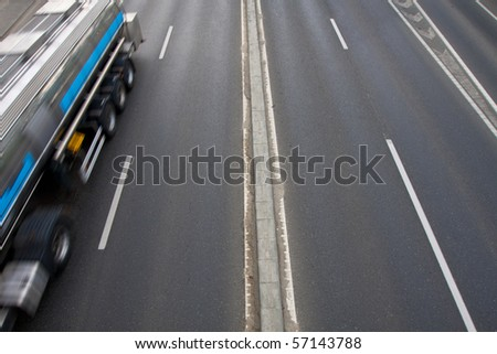 4-lane road with a truck on it