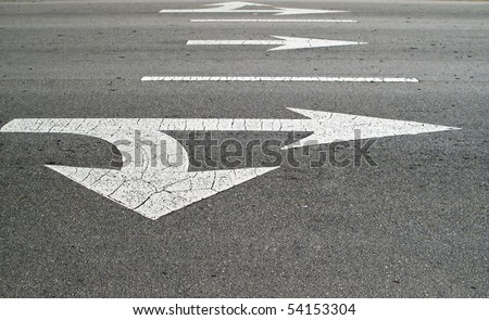 3 lanes of traffic with directional arrows.