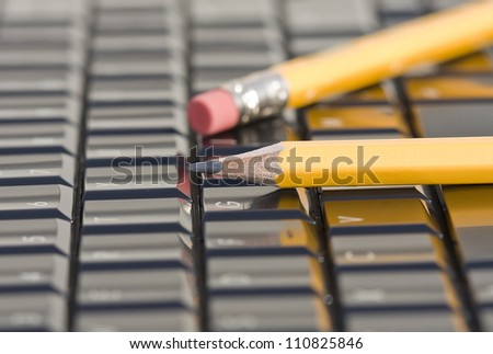 laptop keyboard and pencil