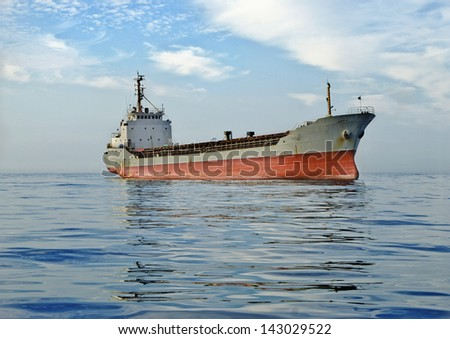 large cargo ship at sea  background of blue sky in the calm