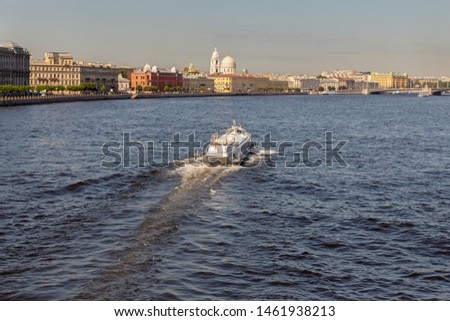 Large pleasure boat on hydrofoils on the Neva River in the city of St. Petersburg on the background of beautiful ancient architecture