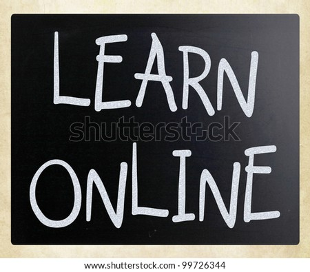 """Learn online"" handwritten with white chalk on a blackboard"