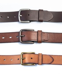 leather belt isolated on white background. Men`s belt. Leather belt with metallic clasp