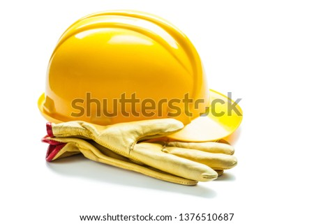 leather gloves  and construction yellow helmet isolated on white