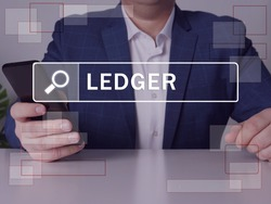 LEDGER text in search line. Marketing expert looking for something at smartphone. LEDGER concept.