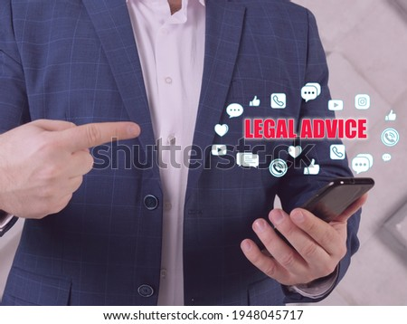 LEGAL ADVICE text in search bar. Businessman looking at cellphone. The giving of a professional regarding the substance or procedure of thelawin relation to a particular factual situation Stock photo ©