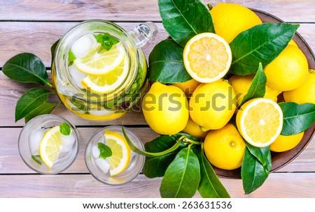 Lemon infused water with mint leaves in glasses and jug.Healthy drink, detox, dieting beverage.