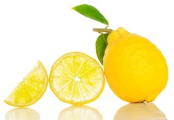 Lemon  whole and slices with green leaves. Isolated on white