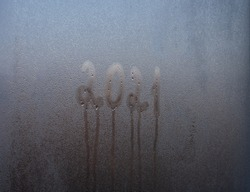 2021 lettering on misted glass. The concept of the outgoing year.