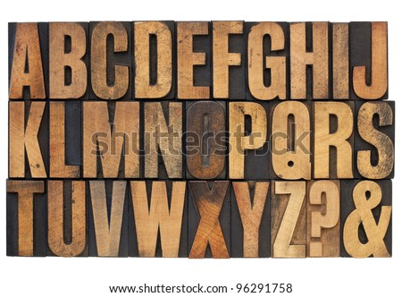 26 letters of English alphabet, question mark and ampersand - antique letterpress wood type printing blocks stained by ink patina
