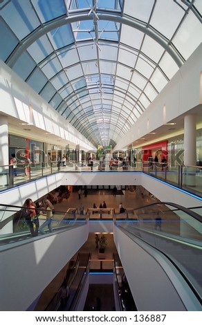 3 levels of a shopping mall with glass top.