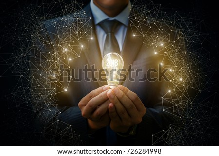 2018 light bulb as an idea in the hands of the businessman. The concept of a new year.