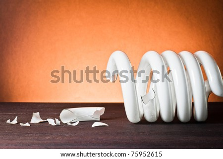 ,light bulb broken on wood,