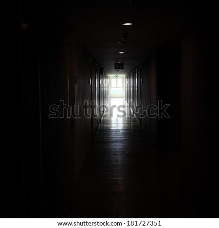light from window in dark building walkway,  walkway in high building background #181727351