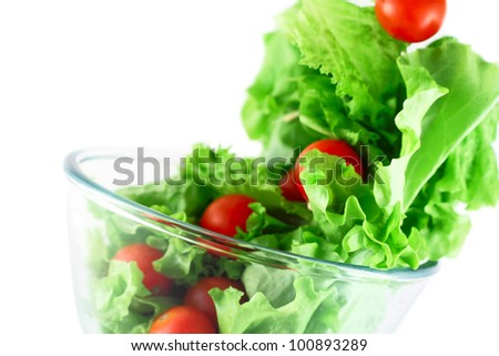 Light lettuce and cherry tomatoes salad close-up isolated on white lightness concept - stock photo
