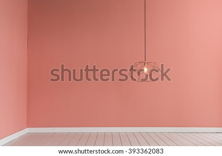 light pink color wall with modern lamp and empty concept