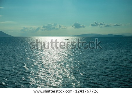 Light reflection and silhouetted boat on the seto inland sea ,Shikoku,Japan