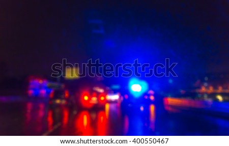 lighting  of police car in the night  during  accident on the road when raining.