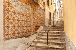 Lisbon, Portugal. Old streets in Alfama.Traditional old tiles on the walls - azulejo.