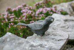 Little bird statue in the park