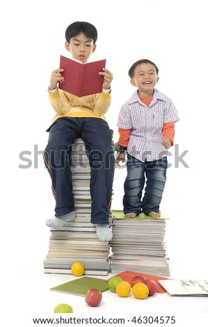 Little cute two boy with many books ,fruit