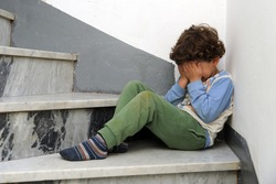 Little European Caucasian children crying sitting on the ground after being punished by parents - violence against minors